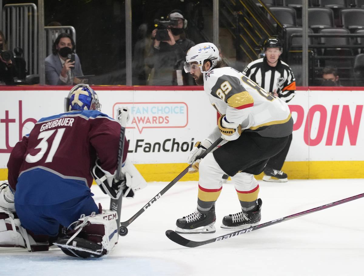 Colorado Avalanche goaltender Philipp Grubauer, left, stops a shot by Vegas Golden Knights righ ...