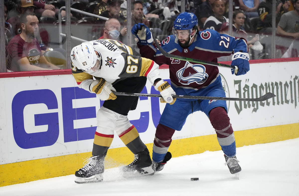 Vegas Golden Knights left wing Max Pacioretty, left, fights for control of the puck with Colora ...