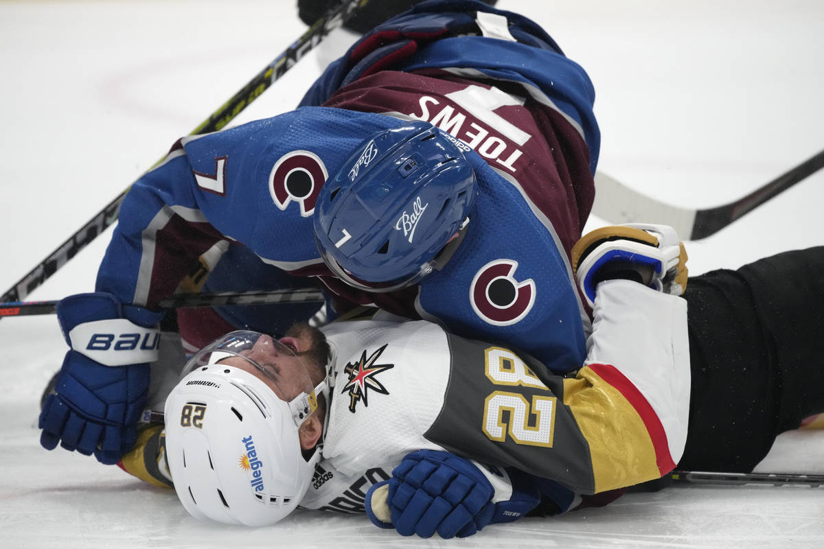 Colorado Avalanche defenseman Devon Toews knocks down Vegas Golden Knights left wing William Ca ...