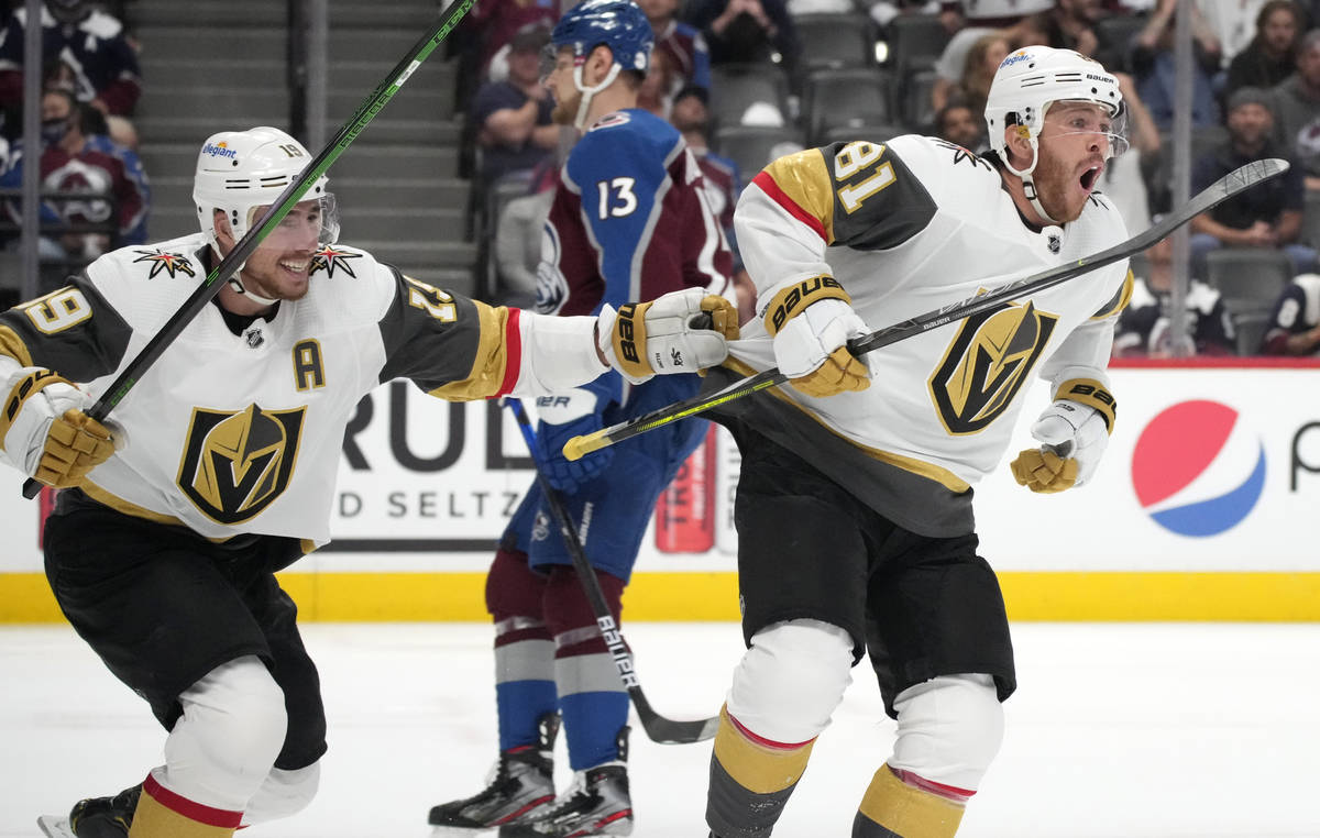 Vegas Golden Knights right wing Reilly Smith, left, celebrates with center Jonathan Marchessaul ...