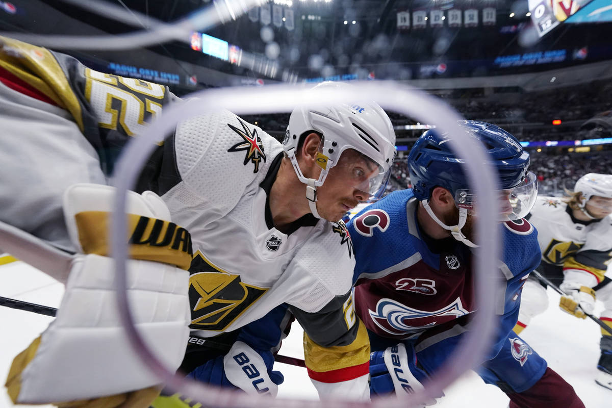 Vegas Golden Knights defenseman Nick Holden, left, and Colorado Avalanche left wing J.T. Comphe ...