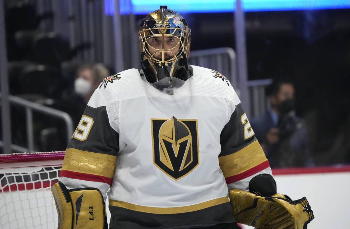Vegas Golden Knights goaltender Marc-Andre Fleury looks into the stands during a timeout in the ...