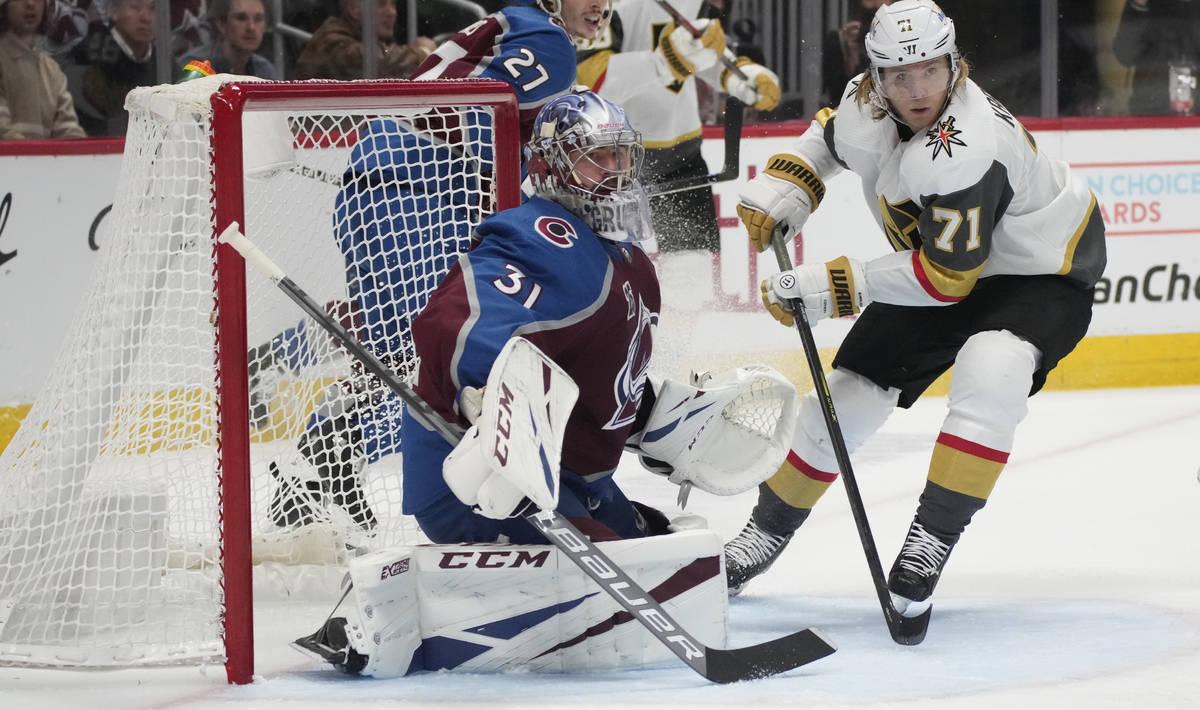 Colorado Avalanche goaltender Philipp Grubauer, left, stops a shot by Vegas Golden Knights cent ...