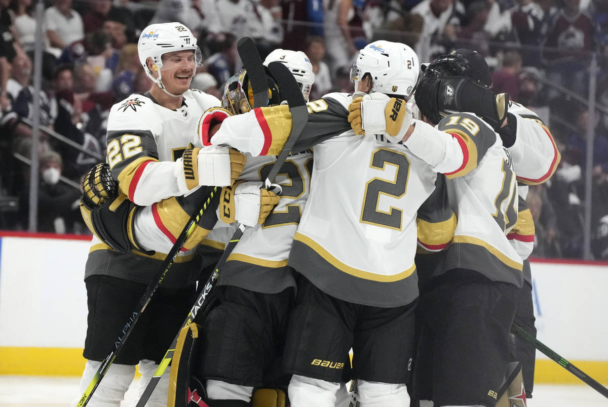 Vegas Golden Knights defenseman Nick Holden celebrates with goaltender Marc-Andre Fleury, defen ...