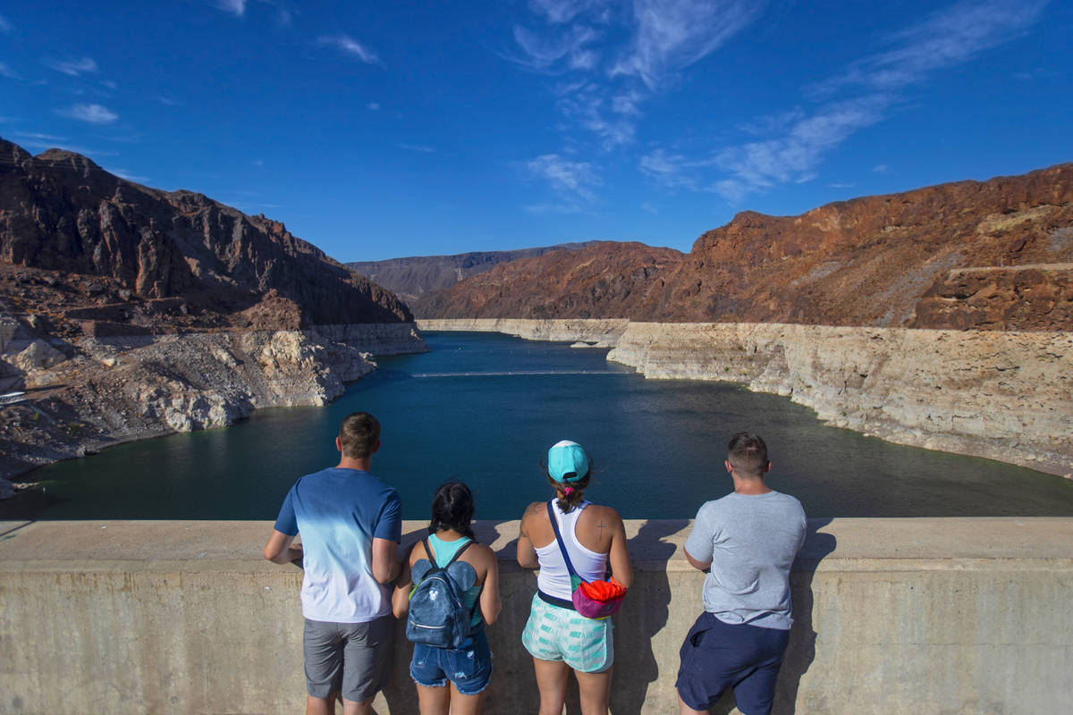 Tourists look out at Lake Mead from the top of the Hoover Dam on Tuesday, June 8, 2021, in Boul ...