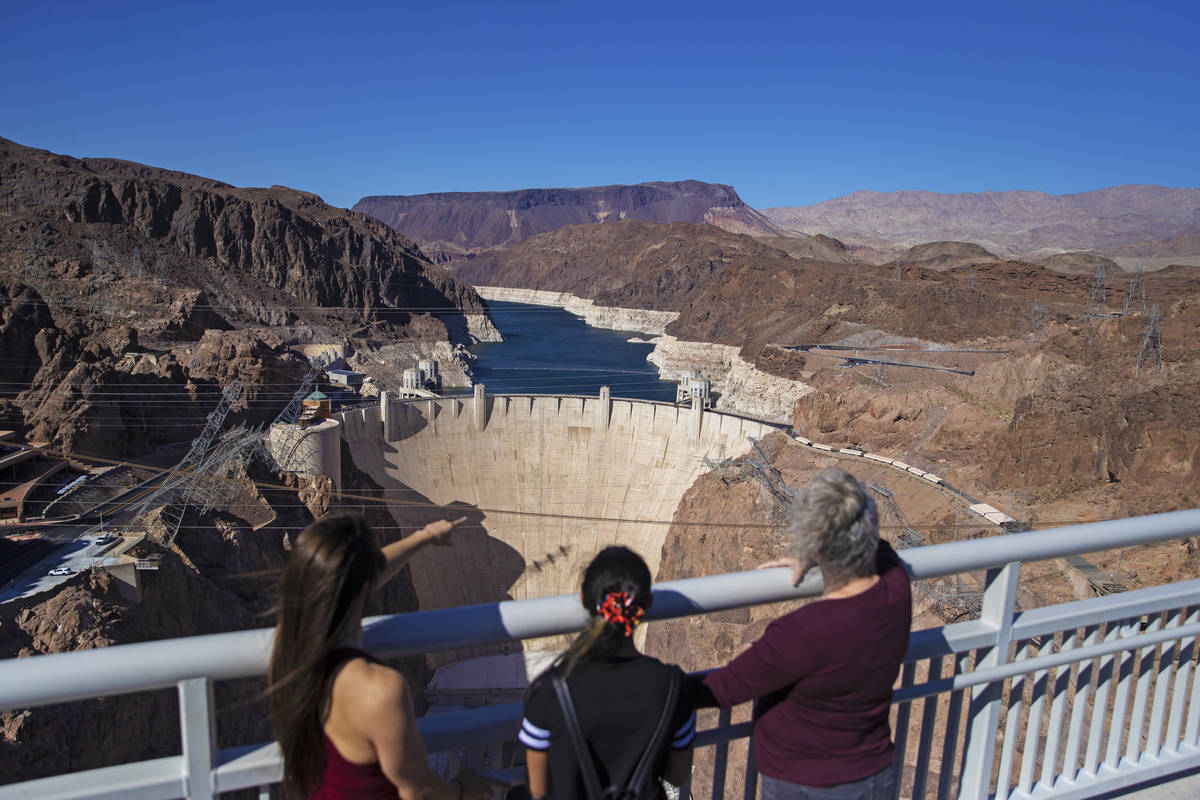 Abigail and Veronica Jones, left, and Pamela Smith look out at Lake Mead and the Hoover Dam whi ...