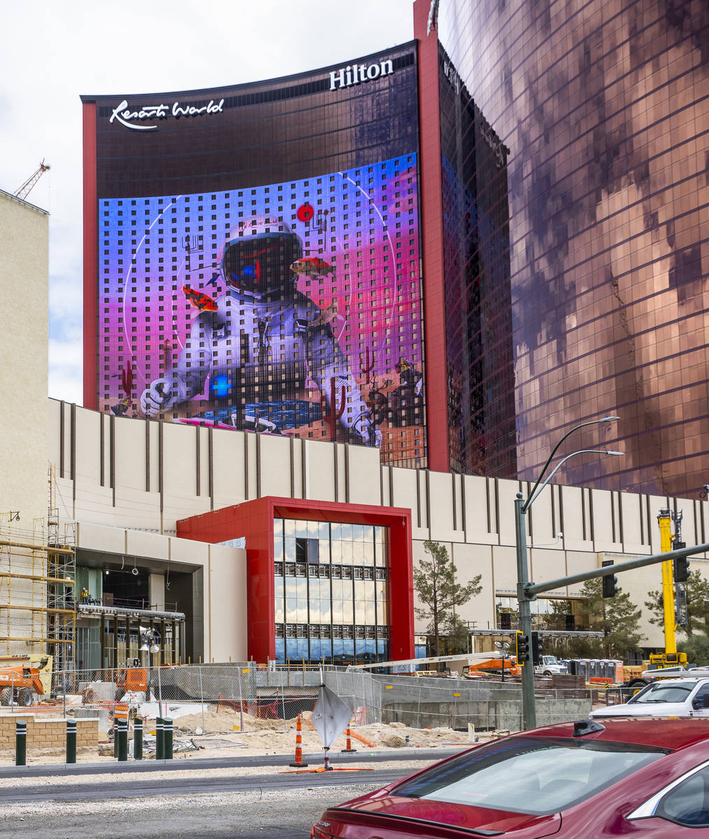 Crews work on the exterior of Resorts World as construction continues on Tuesday, April 27, 202 ...