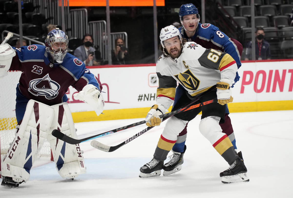 Vegas Golden Knights right wing Mark Stone, front right, calls for the puck while covered by Co ...
