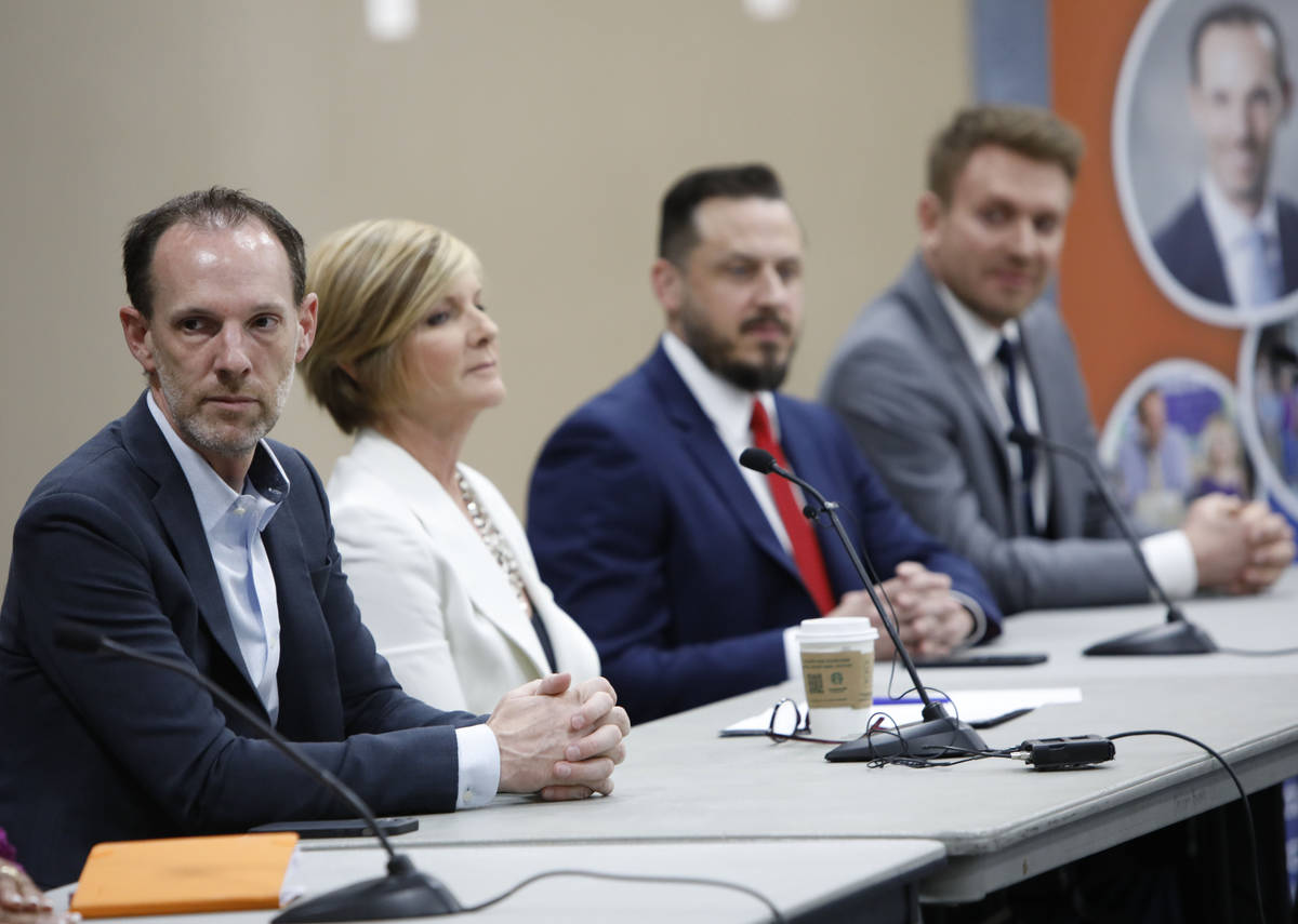 Clark County Commissioner Justin Jones, from left, attend a Housing Resource Talk at Desert Bre ...