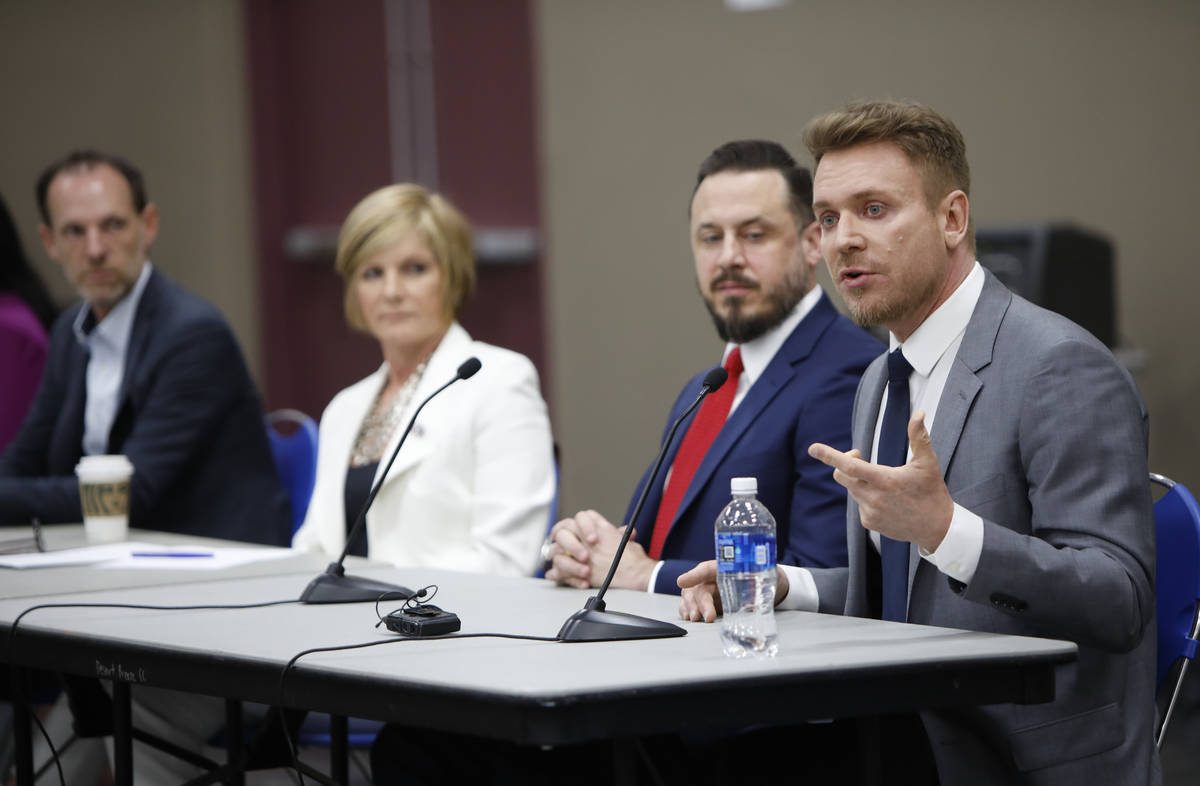 Jim Berchtold, attorney from Legal Aid Center of Southern Nevada, right, speaks during a Housin ...
