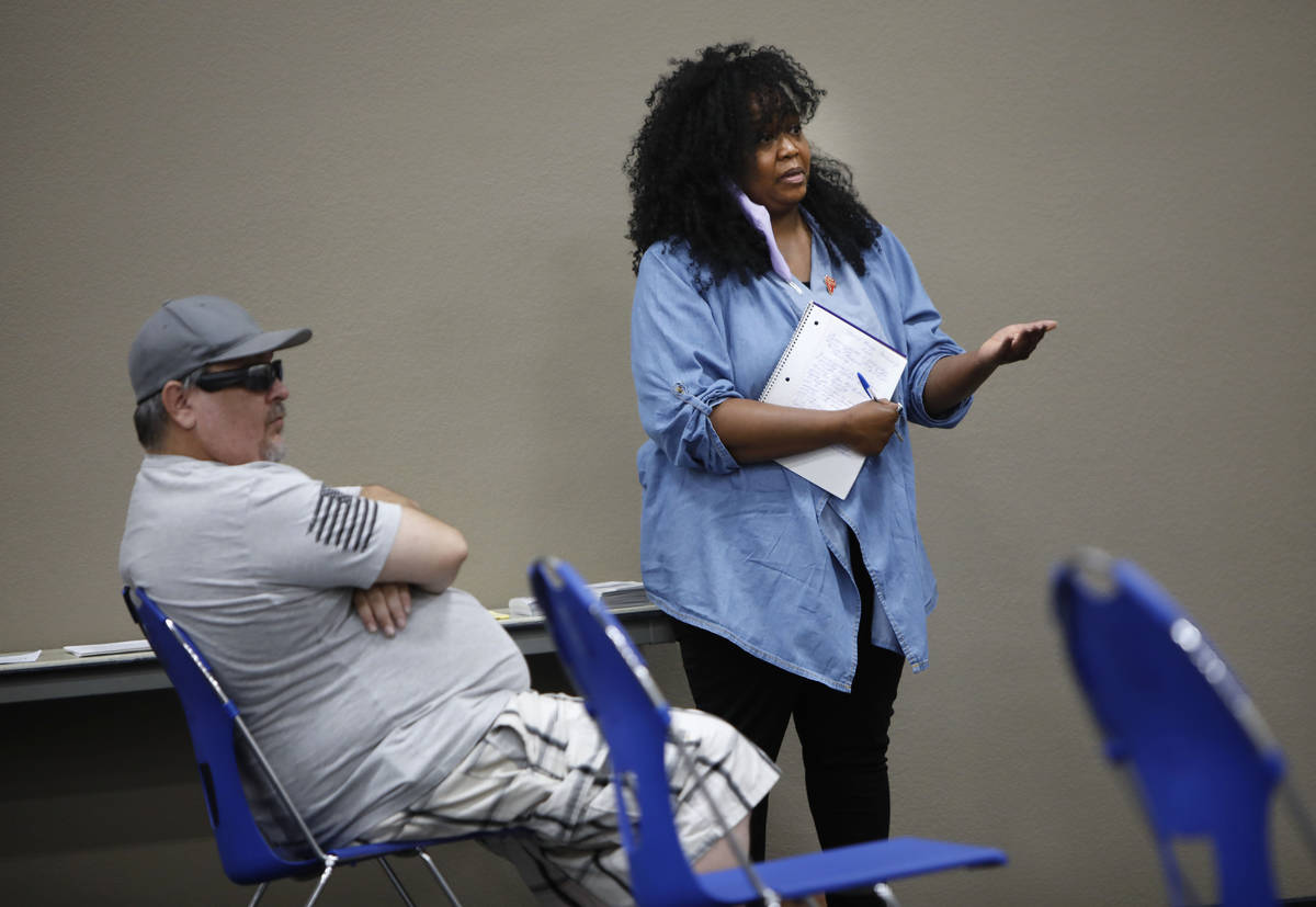Kimberly Ireland of Spring Valley, who is facing eviction, asks a question during a Housing Res ...