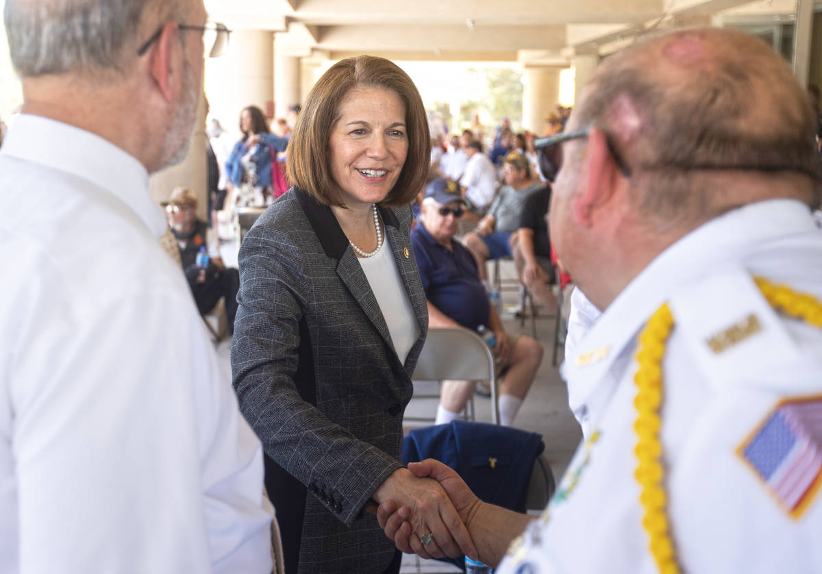 Sen. Catherine Cortez Masto, D-Nev., middle, shakes hands with veterans during a Memorial Day c ...