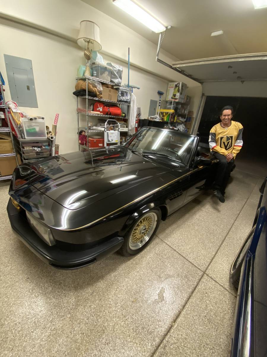 Wayne Newton is shown next to his 1981 Mercedes-Benz 380SL Custom Roadster up for auction at th ...