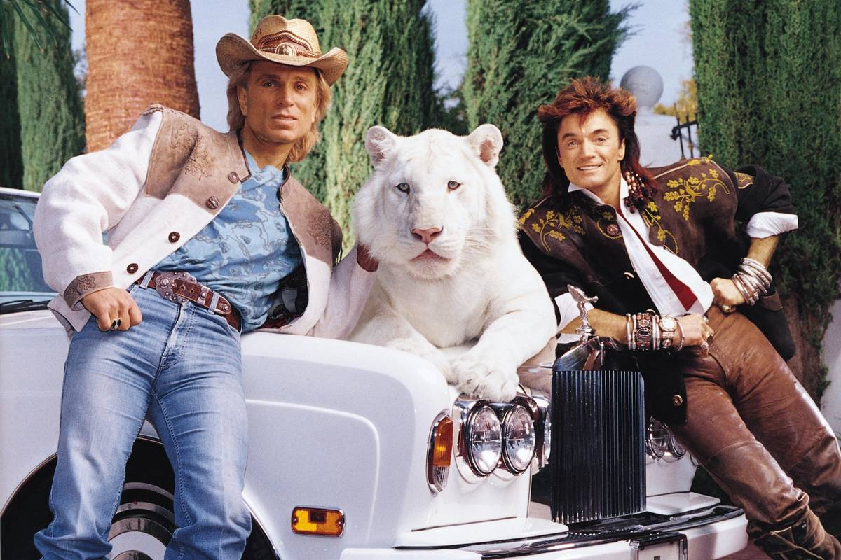 Siegfried & Roy are shown with their 1994 Rolls-Royce Corniche, up for auction at the Barrett-J ...