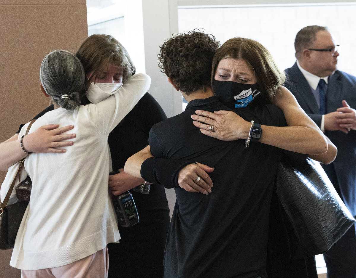 Angela Ahmet, right, and her daughter Jasmine, 17, are comforted by family members after Jordan ...