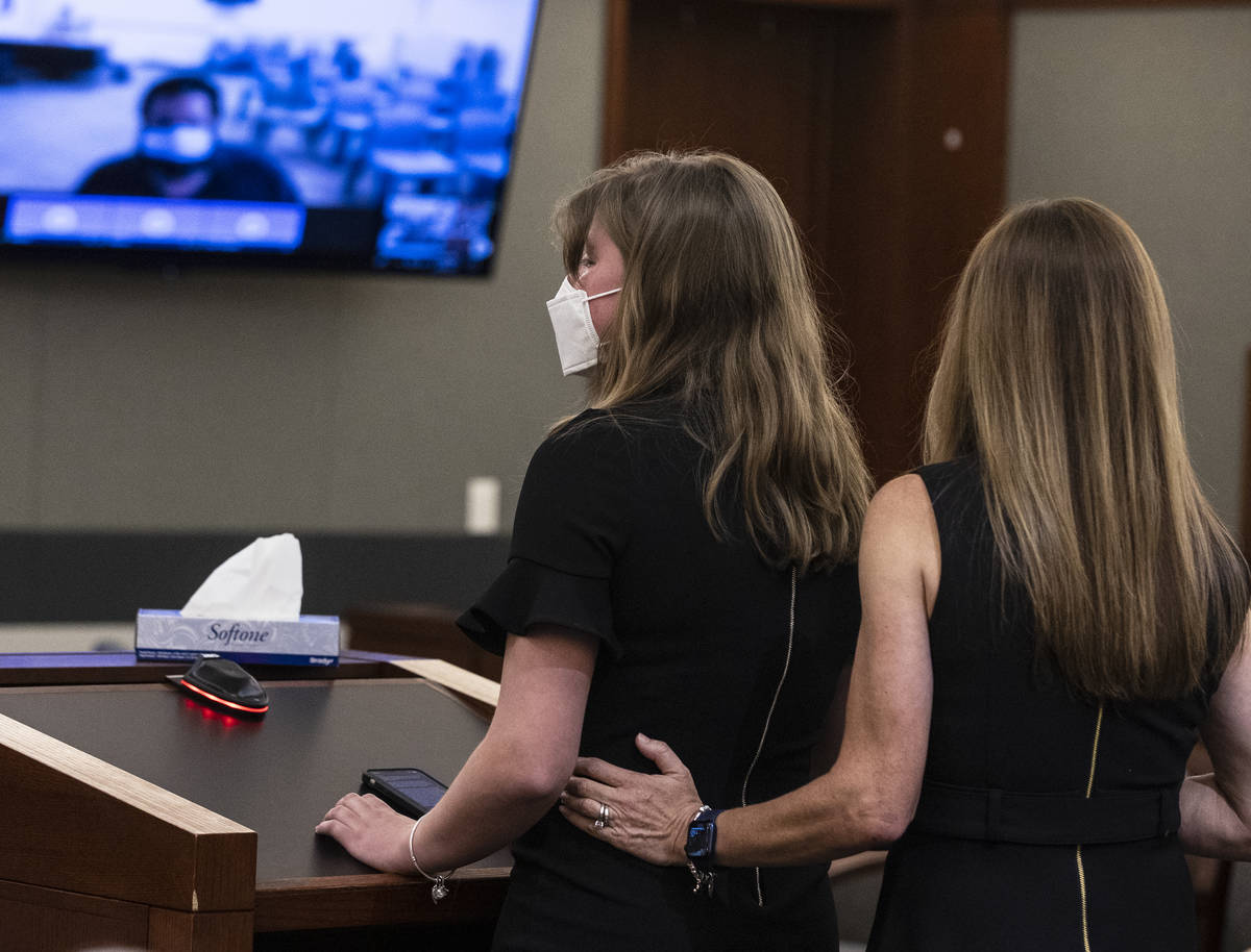 Angela Ahmet, right, comforts as her daughter Jasmine, 17, as she delivers her victim impact st ...