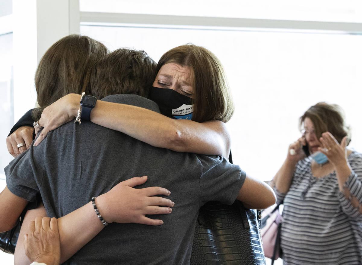 Angela Ahmet, right, hugs her daughter Jasmine, 17, and her son Eren after Jordan BarsonÕs ...