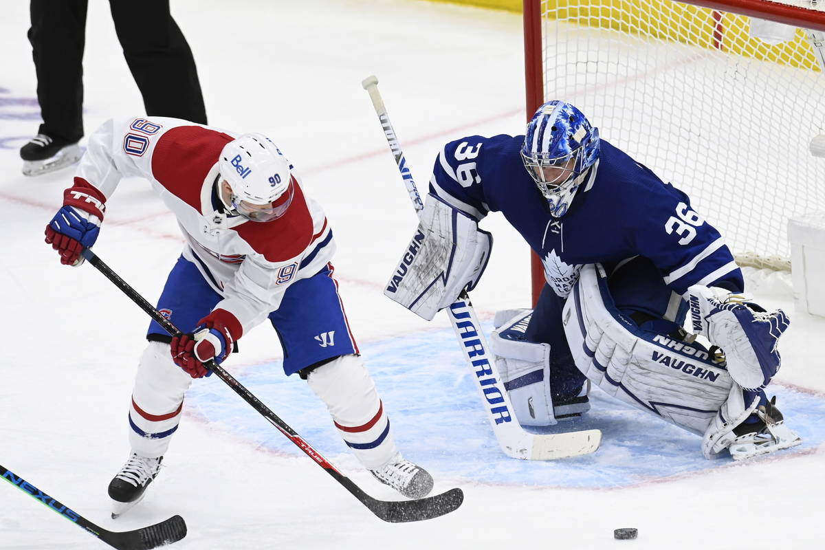 Toronto Maple Leafs goaltender Jack Campbell (36) watches the puck as Montreal Canadiens left w ...