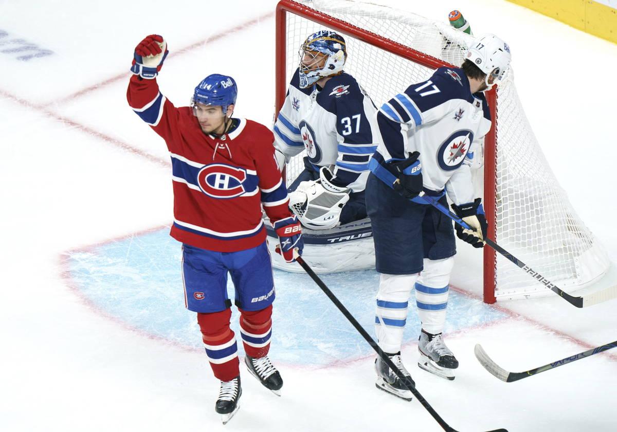 Montreal Canadiens' Nick Suzuki celebrates his goal past Winnipeg Jets goaltender Connor Helleb ...