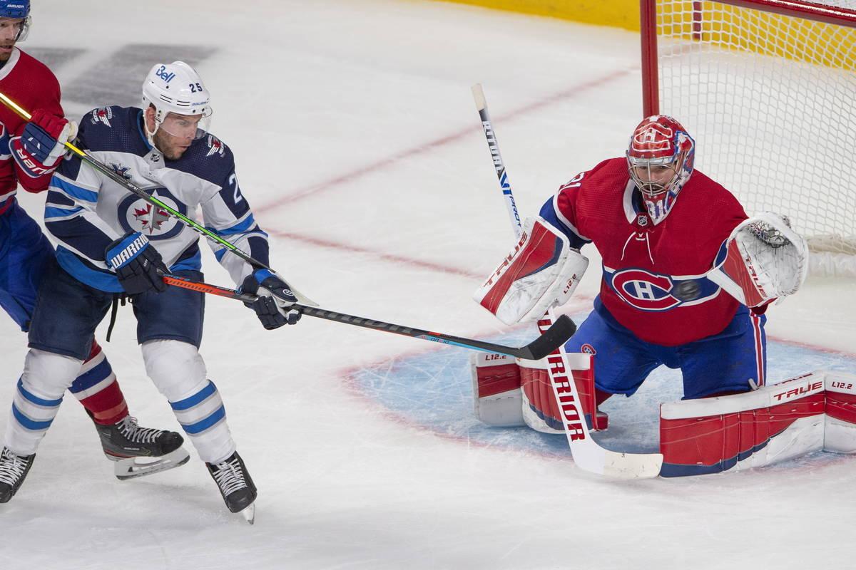 Montreal Canadiens goaltender Carey Price (31) keeps his eye on the puck as he stops Winnipeg J ...