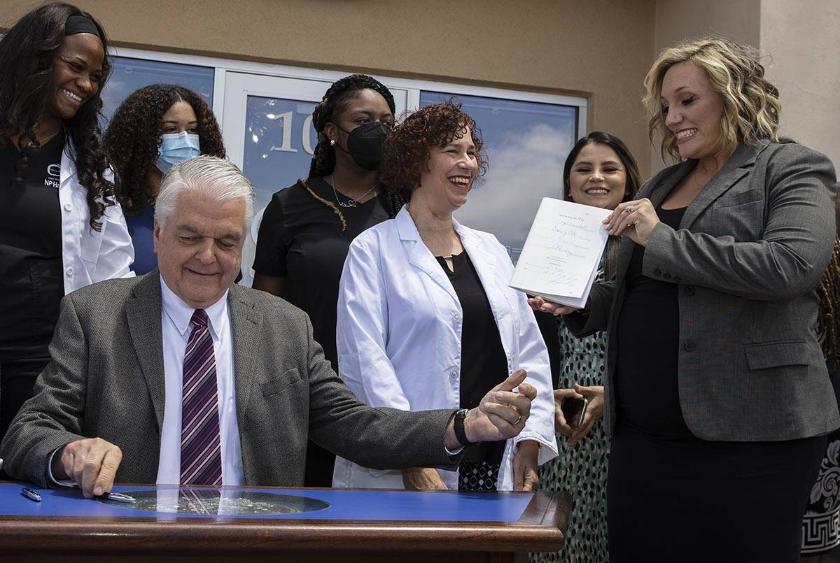 State Majority Leader Nicole Cannizzaro holds Senate Bill # 420, the bill that will provide a p ...