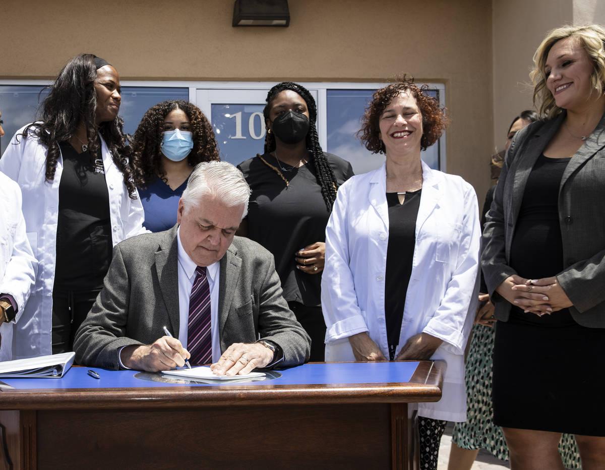 Gov. Steve Sisolak signs Senate Bill # 420, the bill that will provide a public health care opt ...