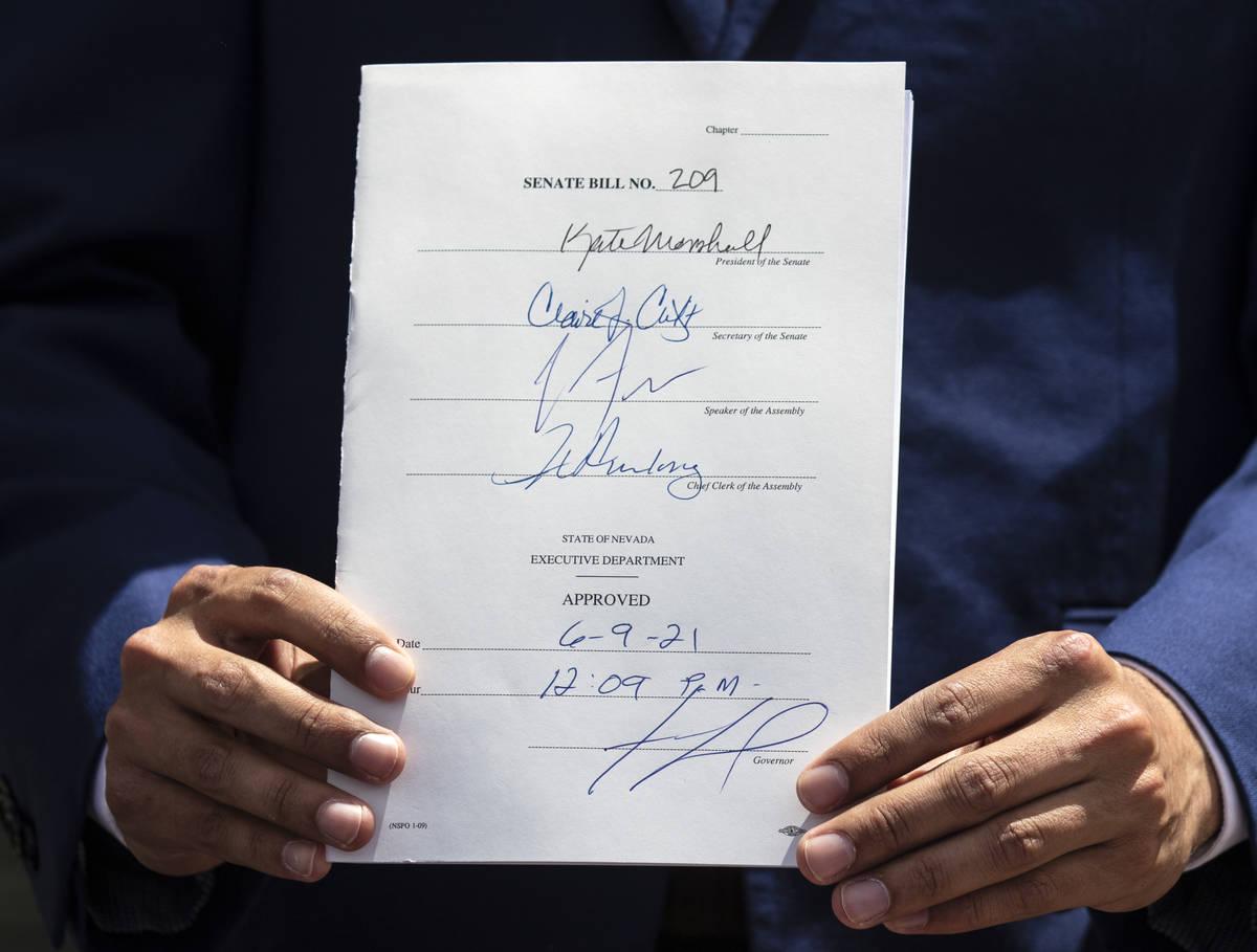 State Senator Fabian Donate holds Bill # 209 after Gov. Steve Sisolak signed the bill, on Wedne ...