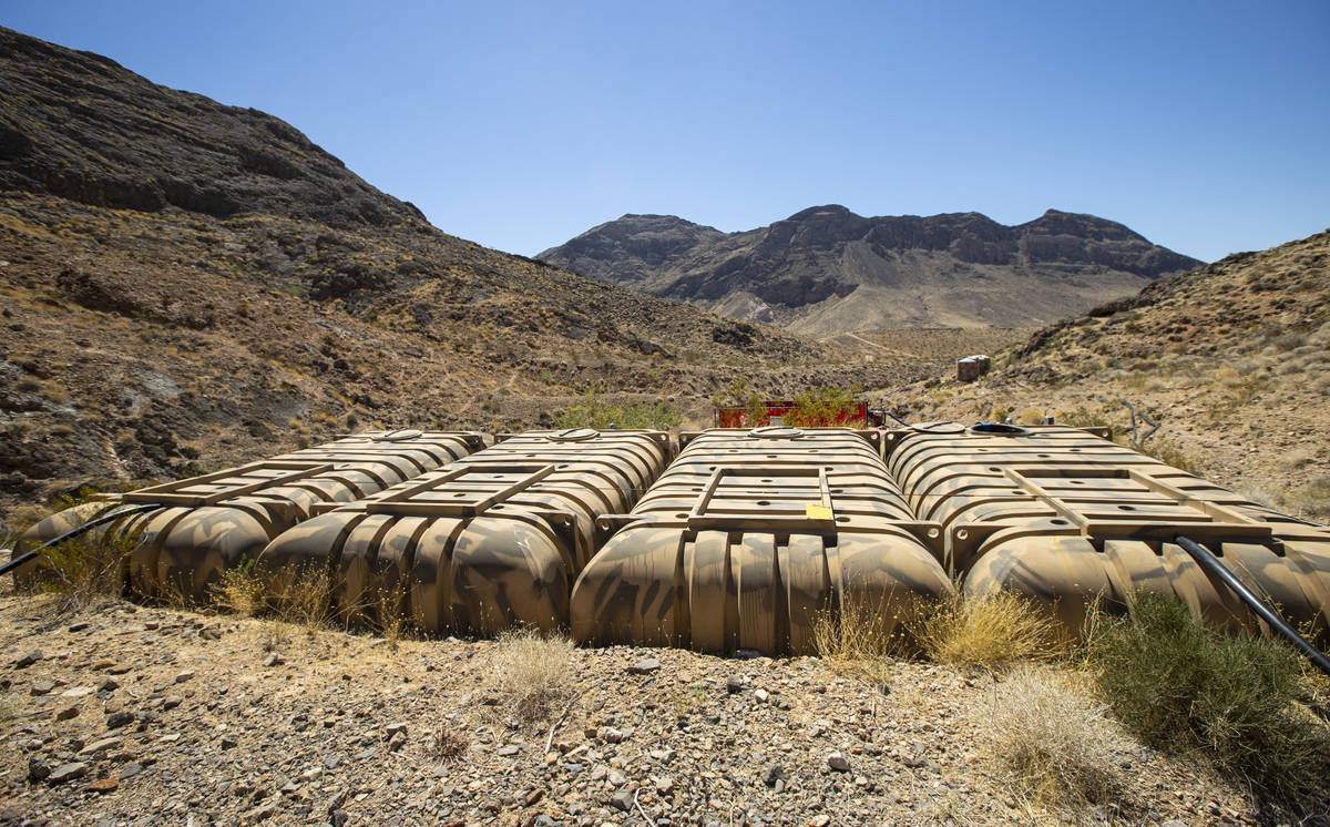 Large water tanks at the flipper guzzler in the Muddy Mountains are seen during an emergency wa ...