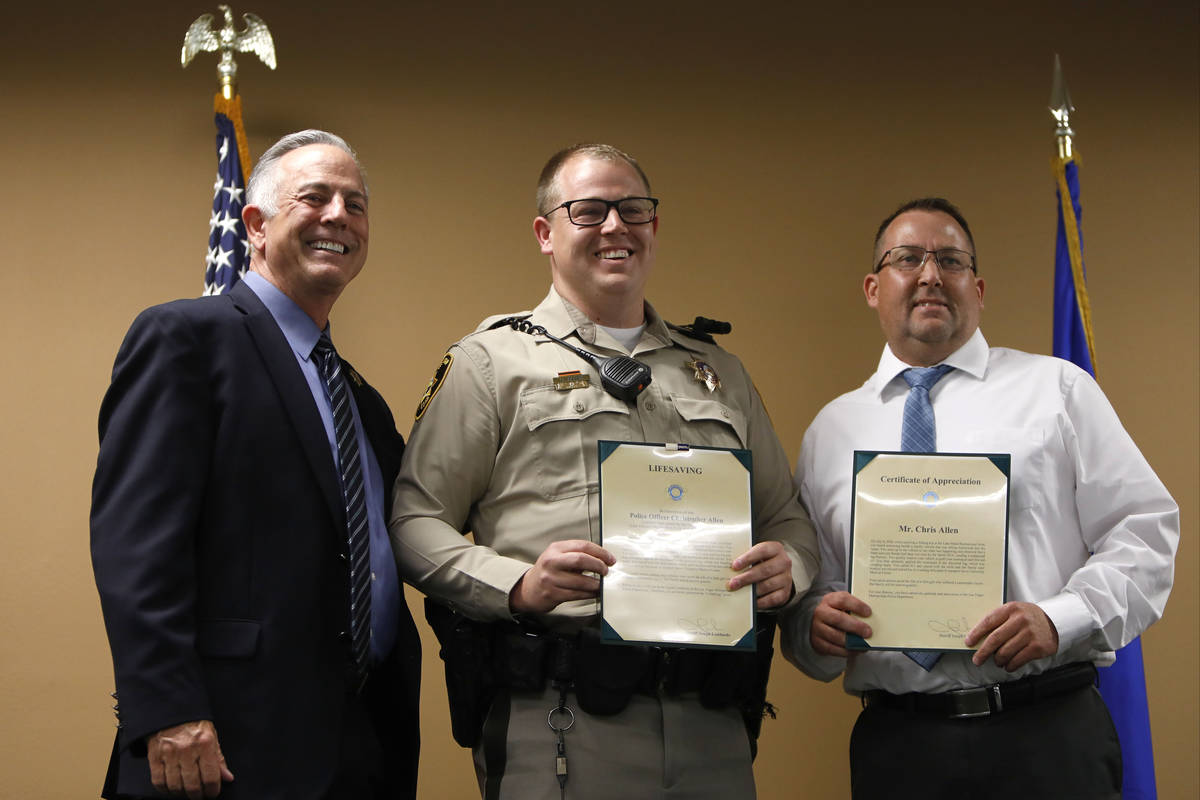 Clark County Sheriff Joe Lombardo, left, poses for a photo with Officer Christopher Ira Allen, ...
