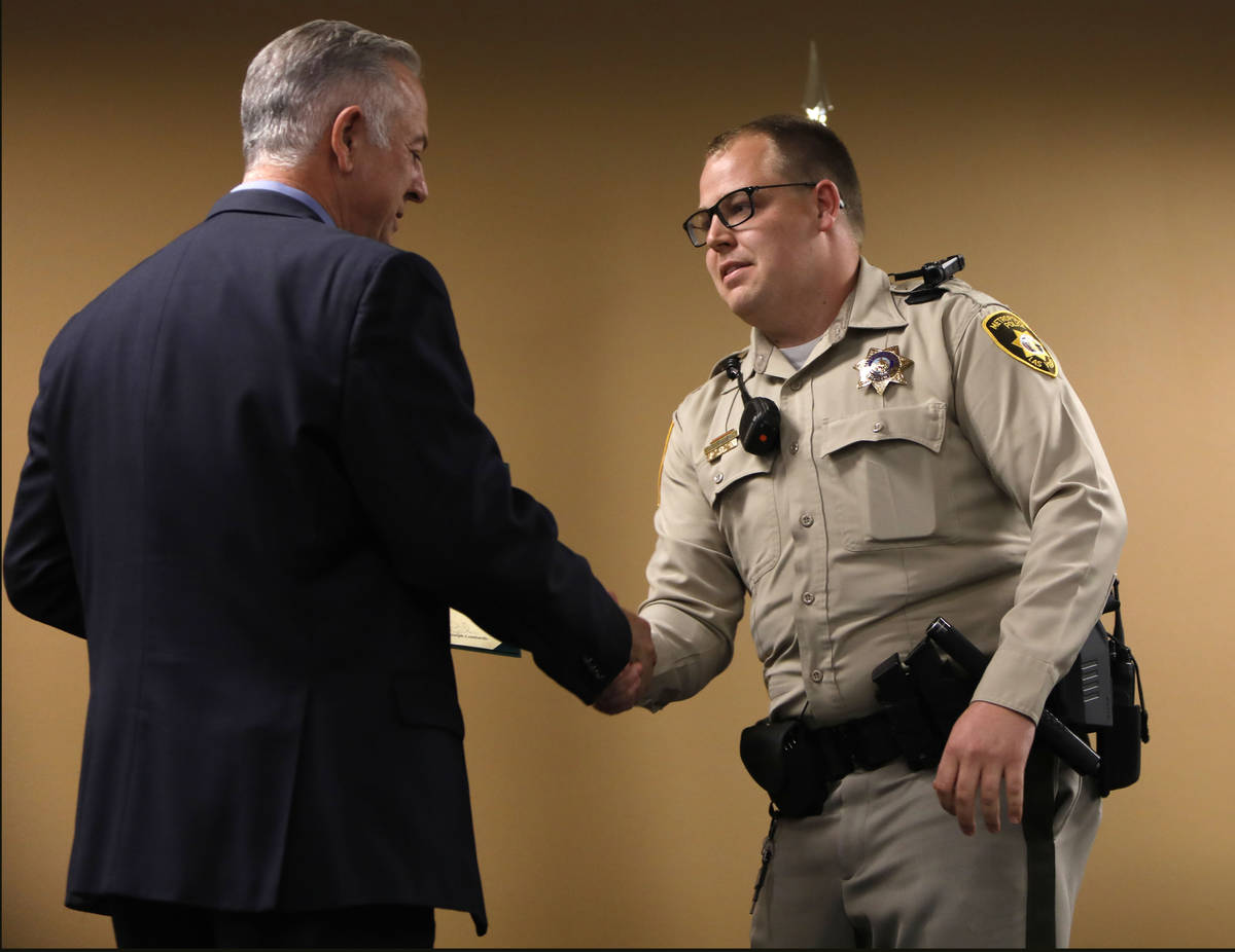 Clark County Sheriff Joe Lombardo, left, shakes hands with Officer Christopher Ira Allen, a lif ...