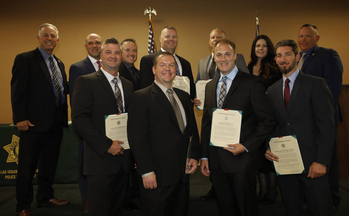 Clark County Sheriff Joe Lombardo, left, poses for a photo with the recipients of unit exemplar ...