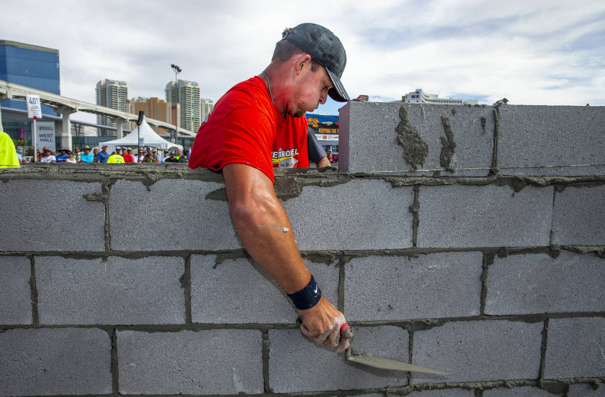 J.T. Payne of Cape Girardeau, MO., scrapes concrete off block in the Fastest Trowel on the Bloc ...