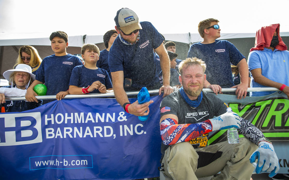 Tender Luke Wikander is cooled off after setting up for the Spec Mix Bricklayer 500 during Worl ...