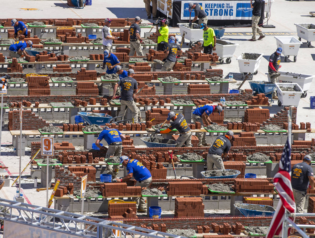 Competitors work their bricks and mortar in the Spec Mix Bricklayer 500 during World of Concret ...