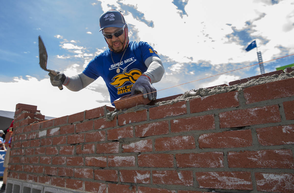 Competitor Jacob Ramirez of Houston, Texas, works his bricks and mortar in the Spec Mix Brickla ...