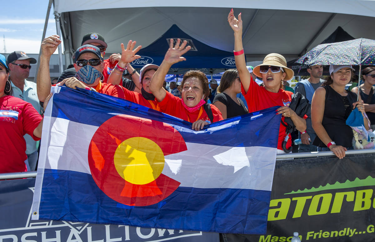Fans of Juan Cabral of Aurora, CO., cheer him on as competitors work their bricks and mortar in ...