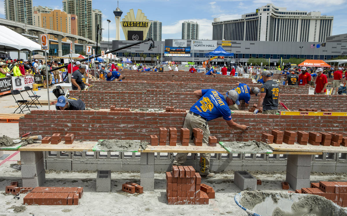 Competitor Darian Douthit of Miami, OK., cleans up his bricks and mortar and will be the eventu ...