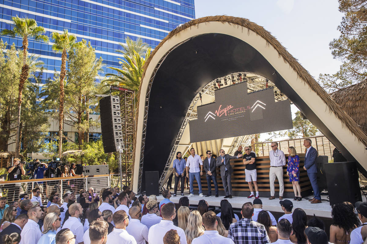 Sir Richard Branson, fourth from right, founder of Virgin Group, is introduced by Richard &#xd2 ...