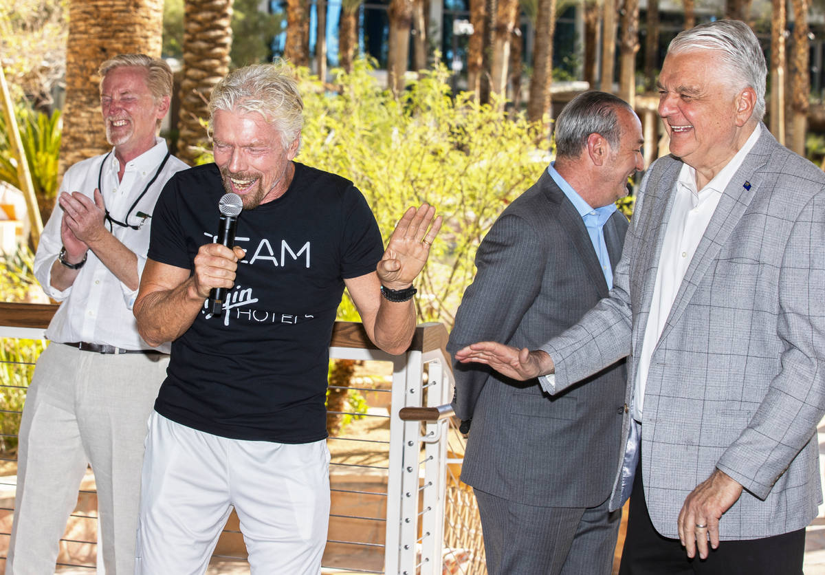 Sir Richard Branson, second from left, founder of Virgin Group, shares a laugh with Gov. Steve ...