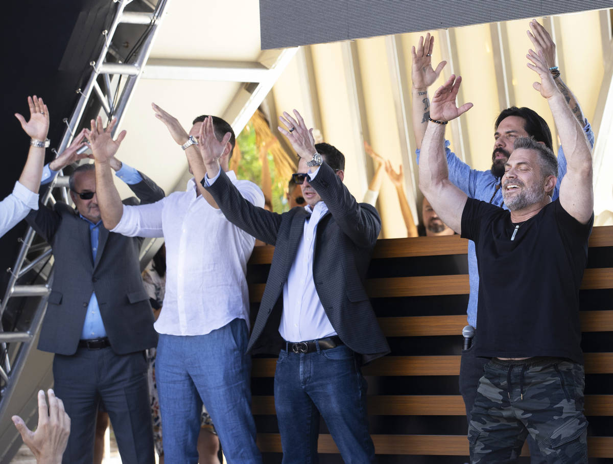"""Damon Damato, right, leads attendees in breathing exercises during the """"Unstoppable Weeken ..."""