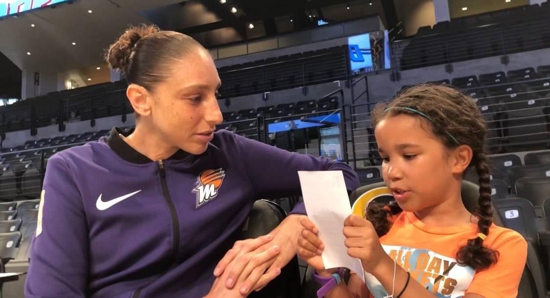 WNBA journalist Pepper Persley, 10, speaks with Phoenix Mercury guard Diana Taurasi, whom many ...