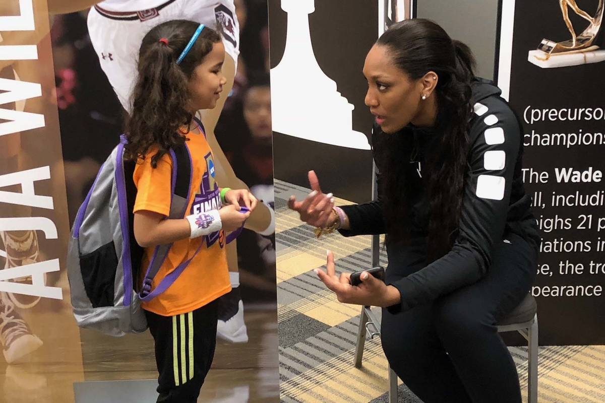 WNBA journalist Pepper Persley, 10, speaks with Aces star forward and reigning WNBA A'ja Wilson ...