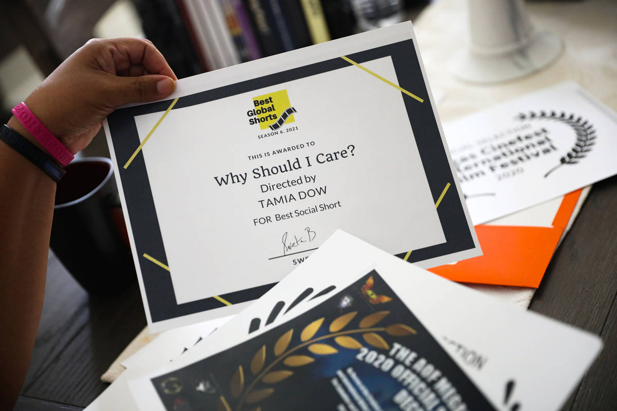 Tamia Dow sorts through awards and recognitions for her work at her friend's home in Las Vegas ...