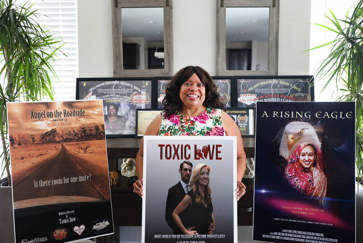 Tamia Dow is surrounded by posters and awards for her films at her friend's home in Las Vegas W ...