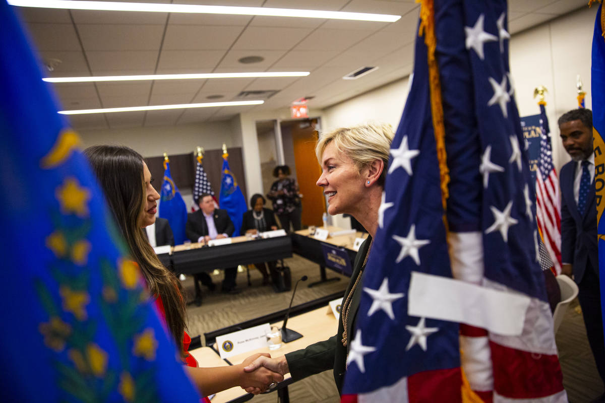 Energy Secretary Jennifer Granholm, right, greets Verna Mandez, deputy director of the Nevada C ...