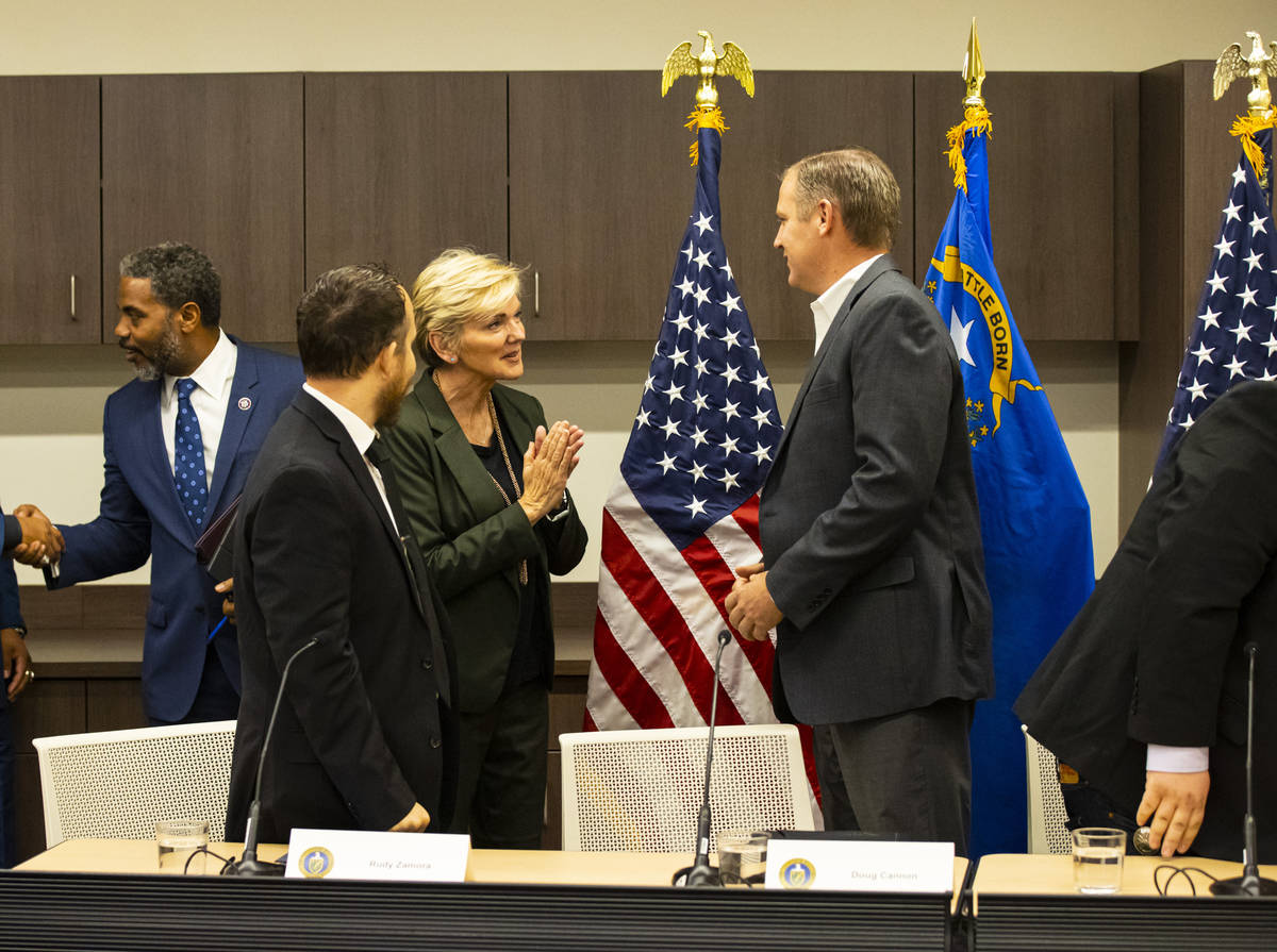 Energy Secretary Jennifer Granholm, third from left, greets Doug Cannon, president and CEO of N ...
