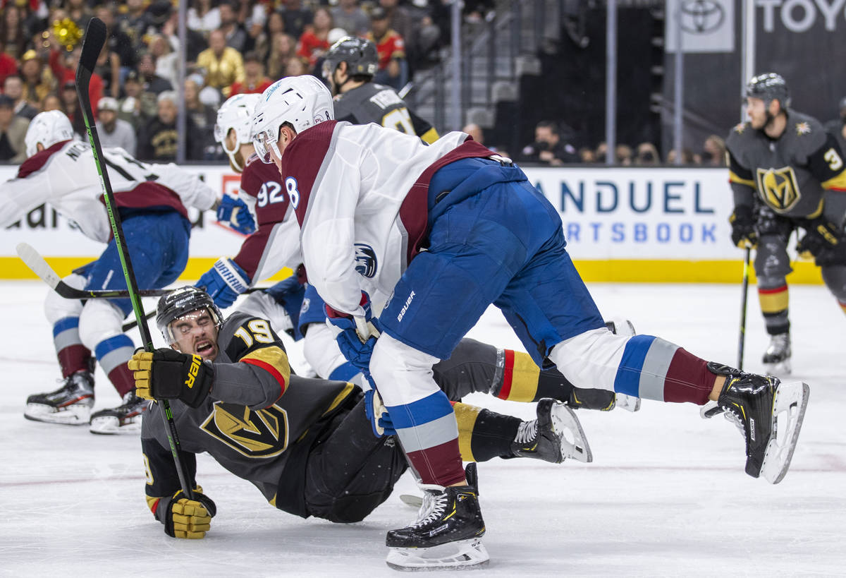 Golden Knights right wing Reilly Smith (19) is taken to the ice after a check by Colorado Avala ...