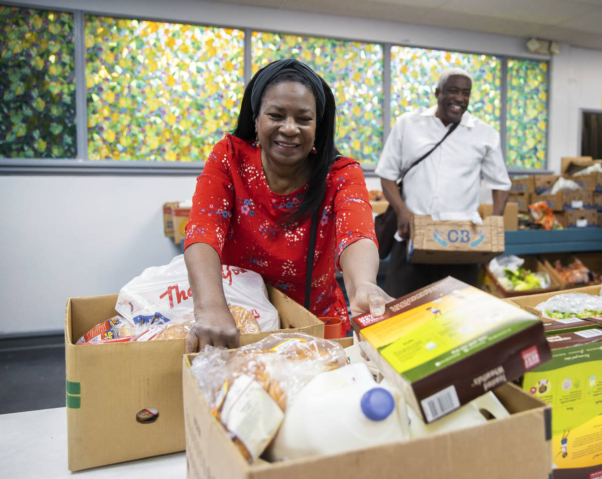 Linda, left and husband Jimmy Stewart shop at the food bank at City Impact Center on Tuesday, J ...