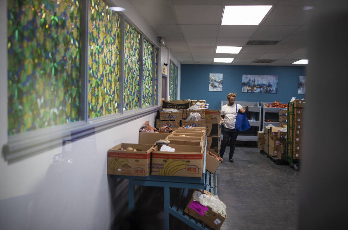 A client shops in the food bank at City Impact Center on Tuesday, June 8, 2021, in Las Vegas. ( ...