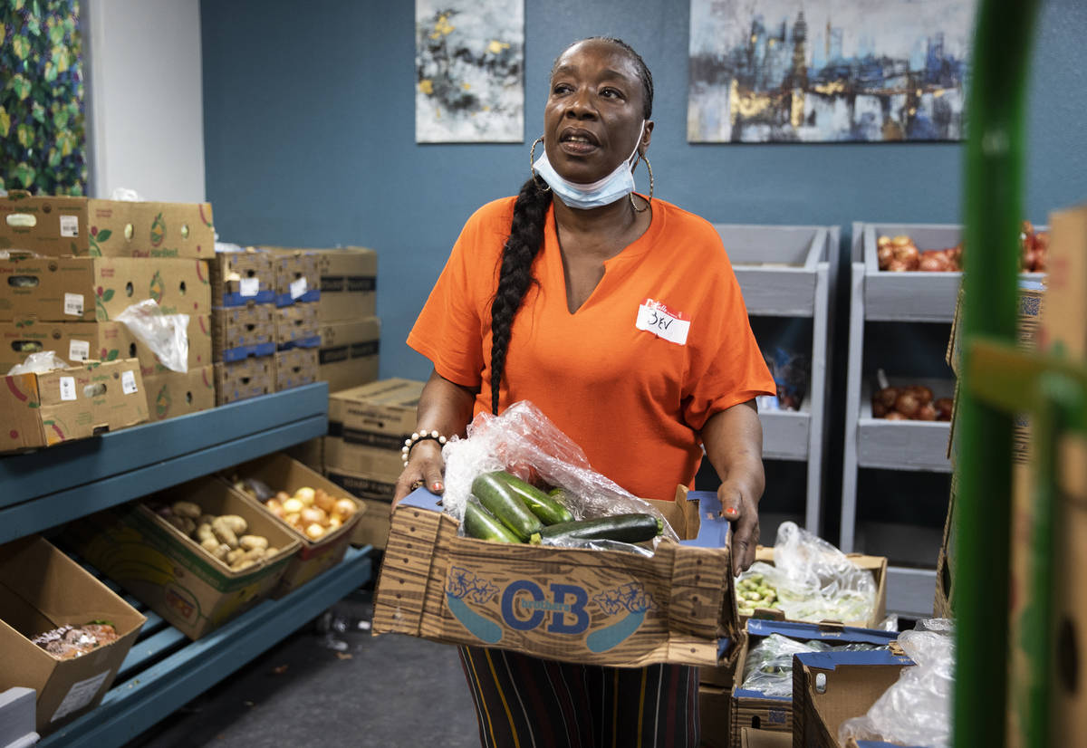 Volunteer Bev Anusionwu works in the food bank at City Impact Center on Tuesday, June 8, 2021, ...